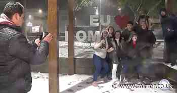 Astonished locals build snowmen and throw snowballs as cold snap freezes Brazil