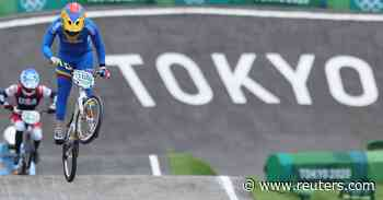 Cycling-Pajon and Fields safely through to BMX semis - Reuters