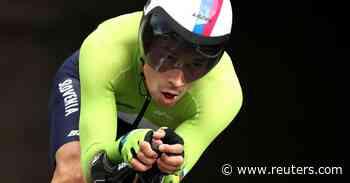 Cycling-Roglic takes road TT gold as Ganna blows it - Reuters