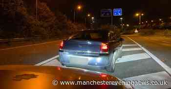 Driver parks on M56 to read Manchester Airport signs