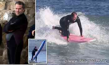 Hunter Biden, 51, dons a VERY tight wetsuit and hits the beach with surf legend Strider Wasilewski
