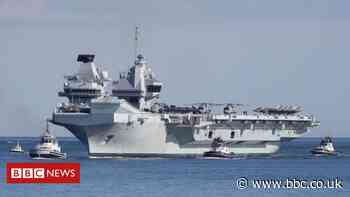 China warns UK as carrier strike group approaches