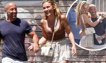 Chrishell Stause looks smitten with new beau Jason Oppenheim during a PDA filled tour of Rome