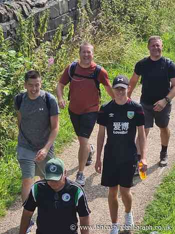 Friends raise over £3000 for sports charity after 75km walk