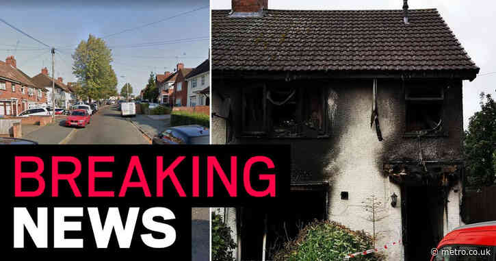 Woman killed after blaze rips through family home as two others escape