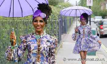 Sinitta flashes her enviable legs in a patterned purple dress