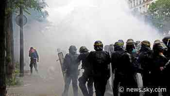 COVID-19: Tear gas fired amid clashes at coronavirus vaccine passport protests in Paris - Sky News