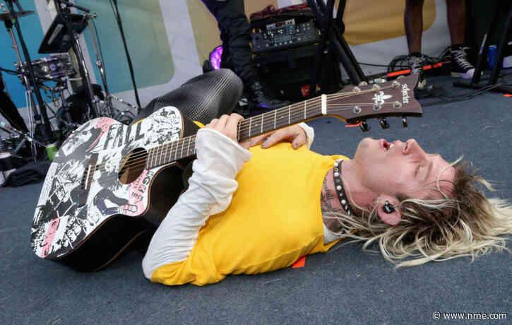 Watch Machine Gun Kelly perform surprise set at Lollapalooza