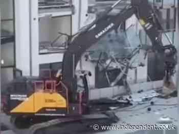 Builder sends digger into apartment block 'because he was owed money'