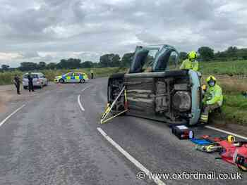 Crews free woman trapped in car after crash