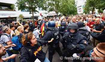 German demonstrators defy court order as thousands violently clash with police on lockdown