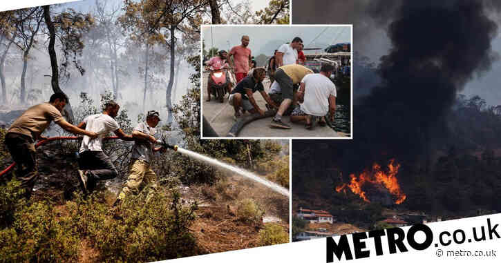 Tourists evacuated by boat as wildfires in Turkey tear through towns along coast