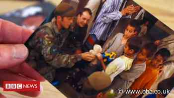 Afghanistan: Orphan's reunion with British soldier after 19 years