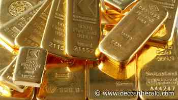 Gold dips as dollar holds ground, US jobs data in focus - Deccan Herald