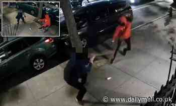 Moment man, 35, is shot in the thigh by a gun-wielding robber on a Manhattan sidewalk