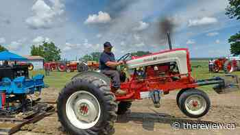 Antique tractors prove their strength at Ste-Anne-de Prescott pull - The Review Newspaper