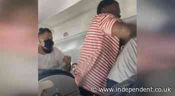 Video shows passengers brawling on flight over reclining seat