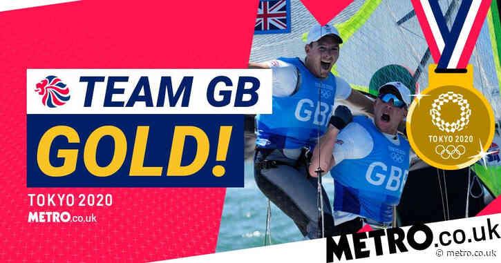 Sailors Dylan Fletcher and Stuart Bithell win gold for Team GB in men's 49er