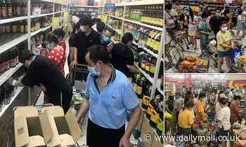 Panic-buying shoppers strip shelves bare in Wuhan after city announces all residents will be tested