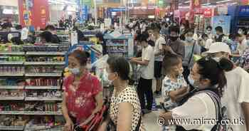 Panic buyers strip shelves in Wuhan as strict lockdown imposed over variant fear