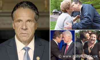 Andrew Cuomo shows pictures of him kissing and touching 'men and women' to refute harassment claims
