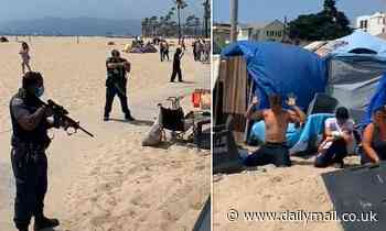 Police point assault rifles at group of homeless people after reports of a gunman at Venice Beach