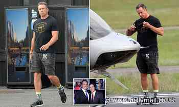 CNN anchor Chris Cuomo arrives at New York heliport as under-fire brother Andrew, 63, clings on
