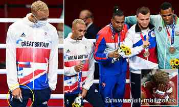 British boxer Ben Whittaker REFUSES to wear his silver medal on the podium and stuffs in his pocket