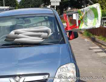 Driver gets warning for transporting ladder in small car