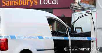 Man fighting for life after being stabbed 'through window of vehicle' as two arrested