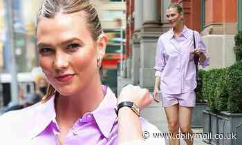 Karlie Kloss is all smiles as she struts around NYC in a lavender dress shirt and shorts set