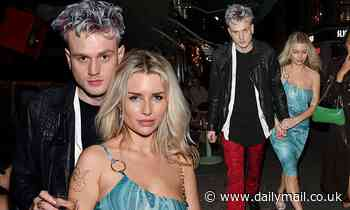Lottie Moss holds hands with her new rockstar boyfriend Tristan Evans