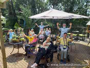 Staff and residents at local care home enjoy perfect weather for their summer party