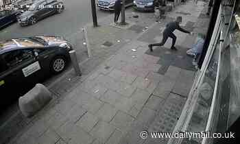 Horror on the High Street: Moment machete thug 'hacks off rival's FINGER' in savage attack