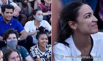Moment AOC puts her mask on for group photo op only to whip it off a minute later