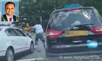 Moment newly-elected Labour mayor brawls with cabbie in road rage row