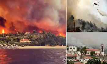 Dramatic footage shows Greek island engulfed in flame as residents are forced to flee across the sea