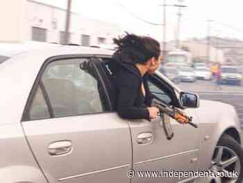 Woman seen leaning out of moving car holding AK47 in shocking San Francisco scene