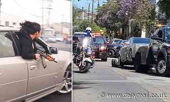 Moment woman leans out car window with an AK47 at illegal speeding event in San Francisco