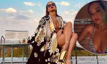 Rita Ora wows in a zebra print bikini before slipping into a luxurious satin dressing gown