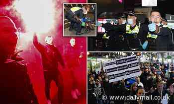 Victoria records six Covid cases as Melbourne protesters hurl BOTTLES at cops at anti-lockdown rally
