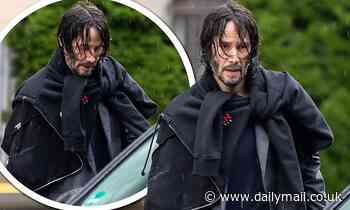 Keanu Reeves sports wet hair after exiting his hotel in Berlin