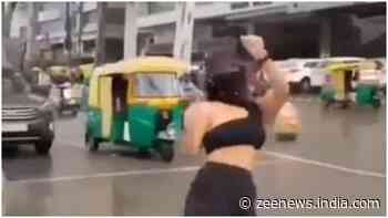 Indore girl dances on traffic light, amused passerby watch her