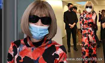 Anna Wintour shows off her signature style in a colourful satin dress