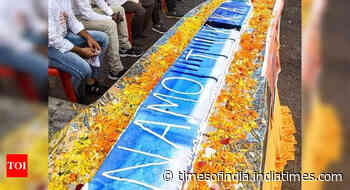 PM Modi's birthday: BJP workers cut 71-feet-long syringe-shaped cake in MP