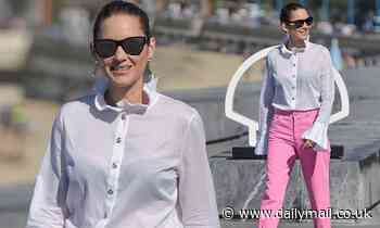 Marion Cotillard showcases her lithe legs in a pair of hot pink jeans at San Sebastian Film Festival