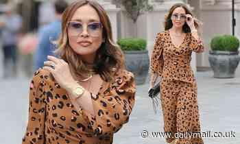 Myleene Klass exudes elegance in a leopard print maxi dress and gold boots