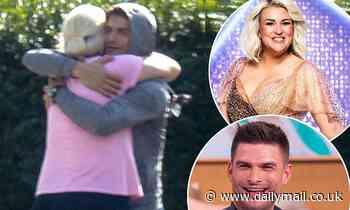 Strictly's Sara Davies embraces proAljaž Škorjanec outside dance studio