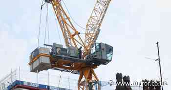 Man rushed to hospital after falling ill inside crane high above the ground