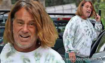 Peter Dante seen for the first time since he was arrested for 'threatening to kill his neighbor'
